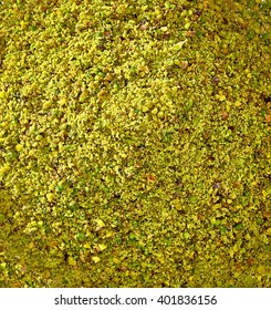 Ground, milled, crushed or granulated pistachio pile from top view
