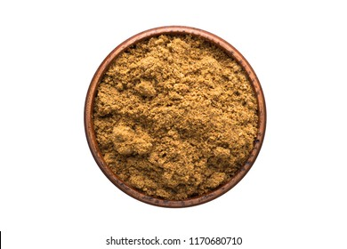 ground nutmeg powder seasoning in a wooden bowl, top view. spice isolated on white