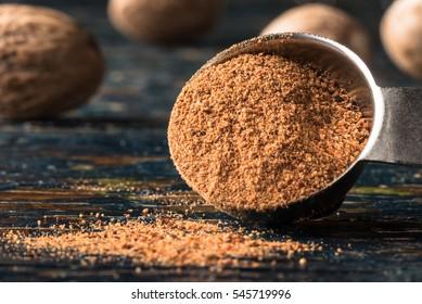 Ground Nutmeg Spilled from a Teaspoon