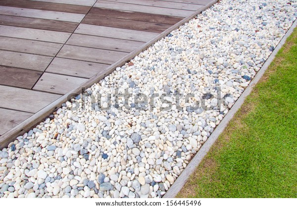 Ground On Wooden Walkway White Stones Stock Photo Edit Now 156445496