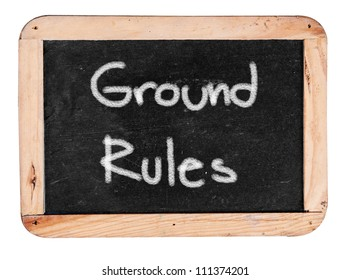 ground rule  - white chalk handwriting on isolated vintage slate blackboard
