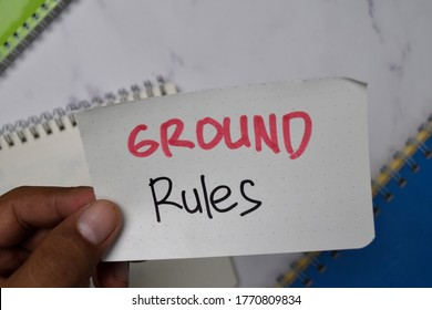 Ground Rules text on sticky notes isolated on office desk.