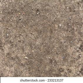 Ground seamless textured surface background under bright sunlight / closeup texture