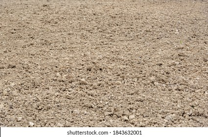 Ground soil as an abstract background close-up.