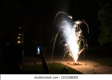 Ground spark shower fireworks or firecrackers in home driveway at night