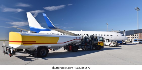 ground staff handling of an aircraft before departure at the airport - refueling and baggage and security checks