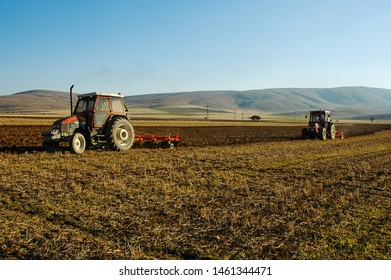 Ground tillage with seeder, plow and seeding at wide fertile plain.