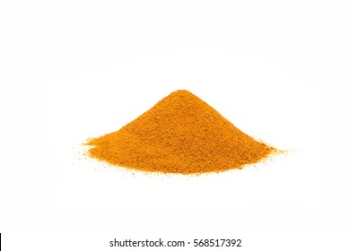 Ground turmeric powder piled on a white background.
