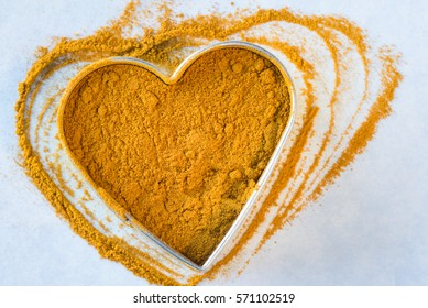 Ground Turmeric Root in a Heart Shape