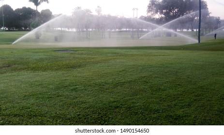 Ground water sprinkler system in golf ground.