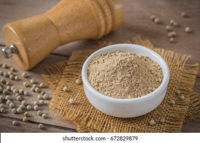 Ground white pepper in bowl and pepper shaker