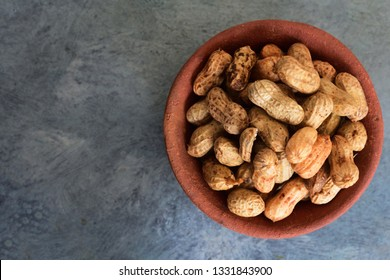Groundnut on red clay pot, groundnut royalty free stock images