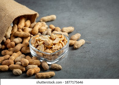 Groundnuts in heart shape plate put next to  a sack of groundnuts