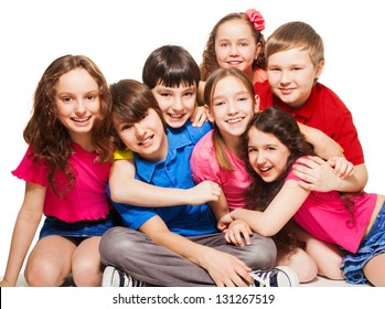 Group of 10 years old kids, boys and girls, hugging, smiling, laughing, on white