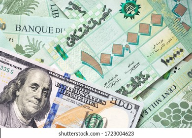 Group of 100 000 Lebanese pounds bills and 100 US dollar bill - Shutterstock ID 1723004623