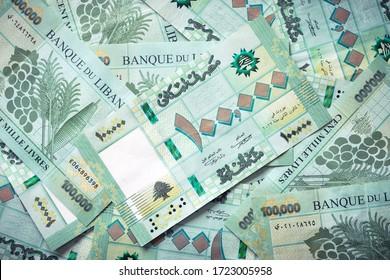 Group of 100 000 Lebanese pounds bills randomly scattered - currency of Lebanon - Shutterstock ID 1723005958