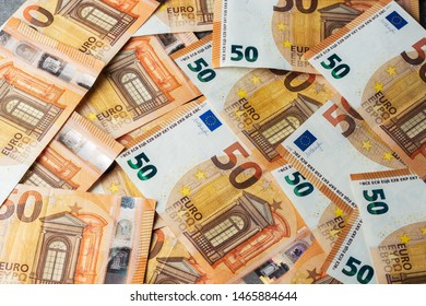 Group of 50 euro notes. Euro banknotes close up. Several fifty euro banknotes Many of one fifty euro banknotes lie side by side. Concept for wealth and investment on grey