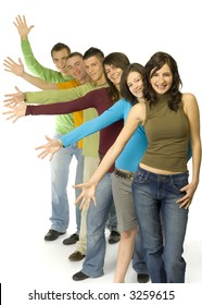 Group of 6 teenagers standing in line. They're waving their right arms synchronically and looking at camera.
