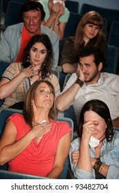 Group of 7 emotional male and female spectators weep