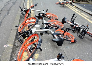 A group of abandoned Mobikes lying in the road, April 8th 2018 in Manchester city centre, UK