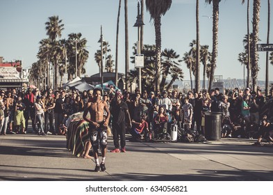 Group of Acrobats performing a show at the Venice Beach promenade for bystanders /  June 2016 / Los Angeles California US