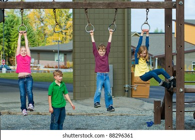 Group of active kids playing at a school playground.