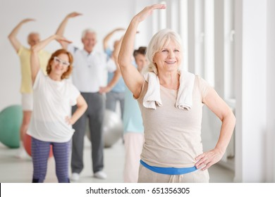 Group of active senior people on fitness classes