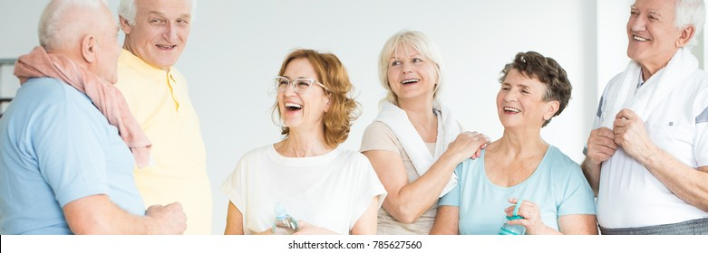 Group of active senior people talking and laughing after physical activity