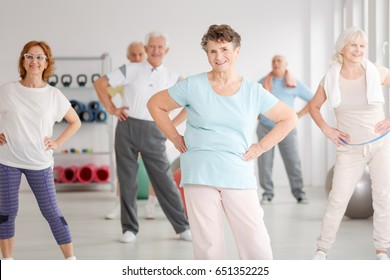 Group of active seniors exercising in fitness club