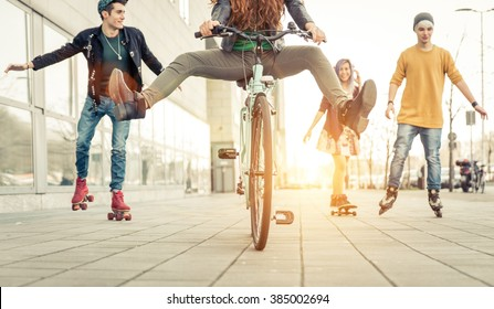 Group of active teenagers in town. four teens making recreational activity in an urban area