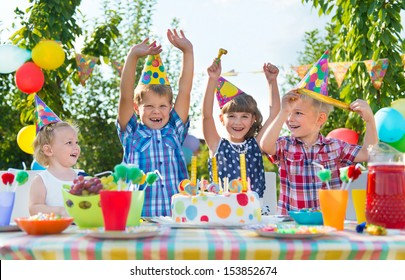 Group of adorable kids having fun at birthday party
