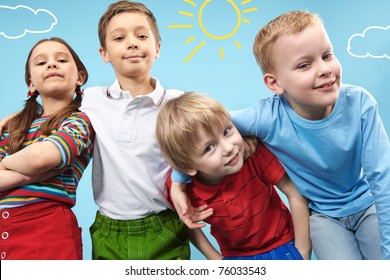 Group of adorable kids looking at camera in creative environment