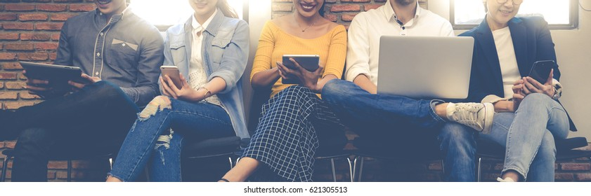 Group Adult Business Friends Sitting Chair Using Modern Gadgets.Business Startup Friendship Teamwork Concept.Creative People Working Together Sale Project.Coworking Wide and brainstorm