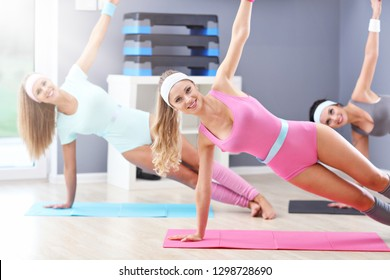 Group of adult women working out in gym
