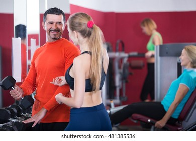 Group adults of different age having strength training in gym
