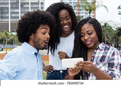Group of african american people looking at phone