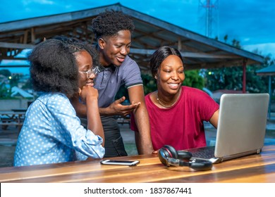 Group of African business millennial partners discussing at a table on laptop-conference call.Concept on people meeting and planning on internet and social distancing