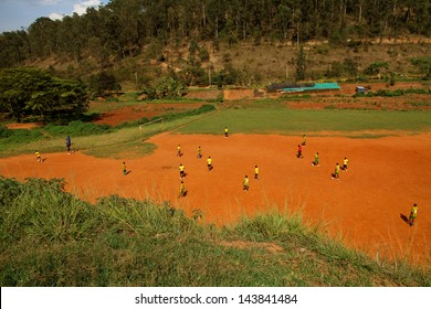 A group of African children, in Rwanda, Kigali, play soccer on a dirt field