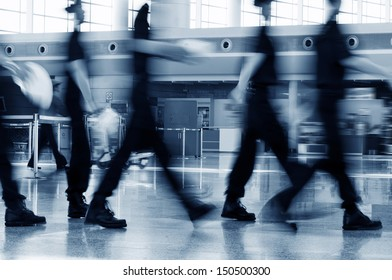 A group of airport security Crew Walking in the Airport