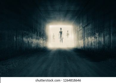 A group of aliens emerging from the light at the end of a dark sinister tunnel. With a high contrast edit.