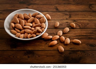 group of almonds on wooden background