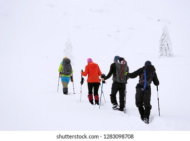 Group of alpinists trekking in harsh winter conditions