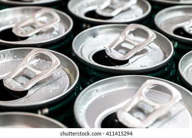 Group of aluminum cans with water drop