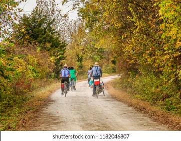 Group of Amish young men and women bicycling on a trail by the bluffs of the Missouri River in the fall