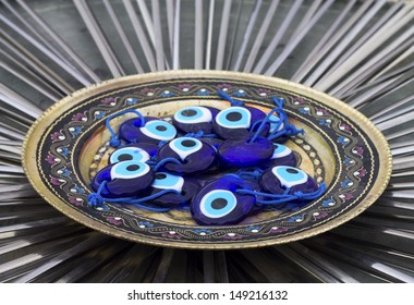 a group of amulets on plate.
