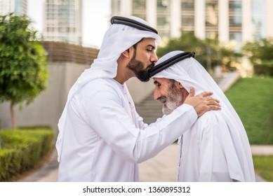 Group of arabian businessmen with kandura meeting outdoors in UAE - Middle-eastern men in Dubai
