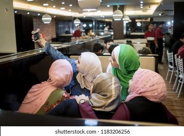 Group of Arabic girls taking selfie
