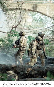 Group army rangers during the military operation soldiers against, marines team in action, at the map