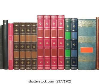 Group of artificial leather bound books, isolated on white background