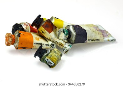 Group of artists paint tubes; used tubes of oil paints, isolated on white ground; differential focus